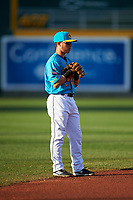 Lansing Lugnuts shortstop Rafael Lantigua (9) during a Midwest League game against the Beloit Snappers at Cooley Law School Stadium on May 4, 2019 in Lansing, Michigan. The Lugnuts wore their Copa de la Diversión jerseys, becoming the Lansing Locos for the evening. Beloit defeated Lansing 2-1. (Zachary Lucy/Four Seam Images)