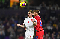 ORLANDO, FL - NOVEMBER 15: Scott Arfield #8 of Canada and Tim Ream #13 of the United States head a ball during a game between Canada and USMNT at Exploria Stadium on November 15, 2019 in Orlando, Florida.