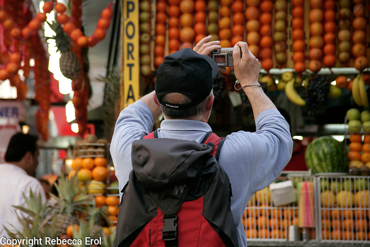 Tourist taking a photo of fruit, Istanbul, Turkey