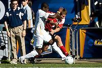 Akron's Kofi Sarkodie (8) battles Louisville's Nick Corliss (6). 2010 NCAA D1 College Cup Championship Final Akron defeated Louisville 1-0 at Harder Stadium on the campus of UCSB in Santa Barbara, California on Sunday December 12, 2010.
