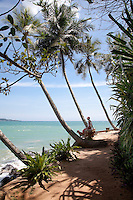 The house is surrounded by 2 acres of exquisite tropical gardens with white sandy paths that lead to many a secluded spot