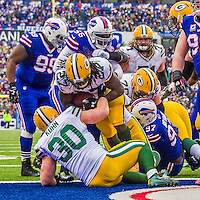 14 December 2014: Green Bay Packers running back Eddie Lacy breaks into the end zone for a one-yard touchdown play in the second quarter against the Buffalo Bills at Ralph Wilson Stadium in Orchard Park, NY. The Bills defeated the Packers 21-13, snapping the Packers' 5-game winning streak and keeping the Bills' 2014 playoff hopes alive. Mandatory Credit: Ed Wolfstein Photo *** RAW (NEF) Image File Available ***