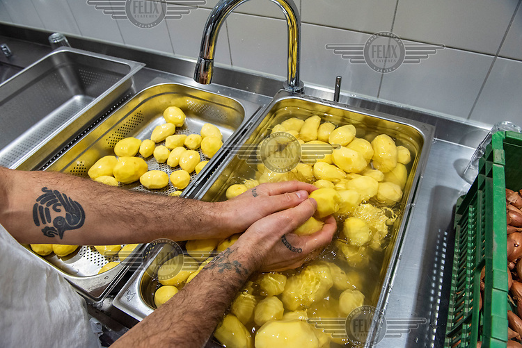 Walter El Nager, 'The Mad Chef', preparing lunch for 100 people in need, with the help of volunteers, part of his Mater Fondazione project, which since the summer has served 16,000 meals from borrowed kitchens.
