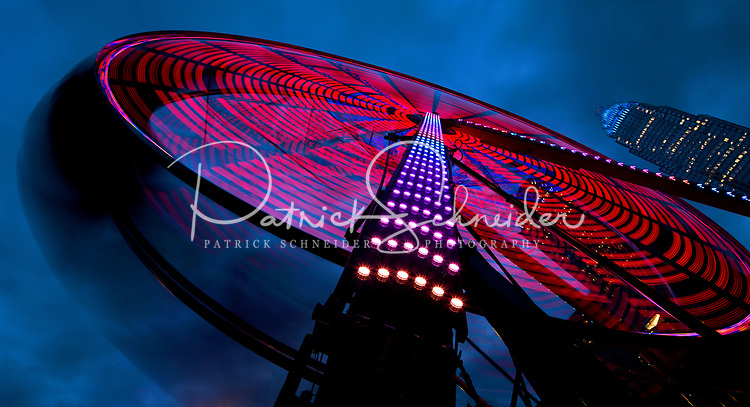 Photography of the Eye on Tryon, an 80-foot  ferris wheel in Uptown Charlotte, North Carolina. The 10 day ride gives the riders a chance to see Uptown Charlotte from a different view. The ferris wheel is located at 7th and Tryon Street.<br /> <br /> Charlotte Photographer - PatrickSchneiderPhoto.com