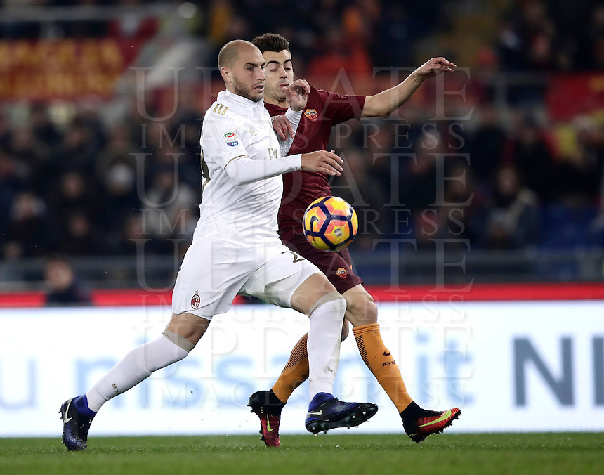 Calcio, Serie A: Roma vs Milan. Roma, stadio Olimpico, 12 dicembre 2016.<br /> Milan's Gabriel Paletta, left, and Roma's Stephan El Shaarawy fight for the ball during the Italian Serie A football match between Roma and AC Milan at Rome's Olympic stadium, 12 December 2016.<br /> UPDATE IMAGES PRESS/Isabella Bonotto