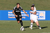 RICHMOND, VA - SEPTEMBER 30: Alex Comsia #4 of North Carolina FC passes the ball away from Jake LaCava #64 of New York Red Bulls II during a game between North Carolina FC and New York Red Bulls II at City Stadium on September 30, 2020 in Richmond, Virginia.