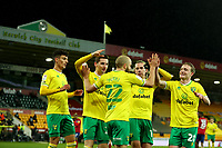 6th April 2021; Carrow Road, Norwich, Norfolk, England, English Football League Championship Football, Norwich versus Huddersfield Town; The Norwich City players celebrate the hat-trick by Teemu Pukki for 6-0