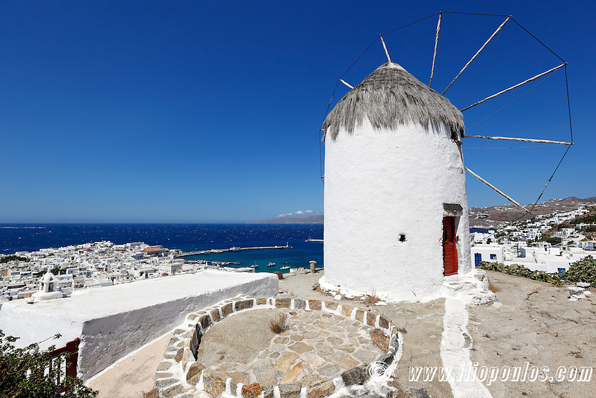 Great view at the port and Chora from a windmill of Mykonos, Greece