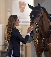 WELLINGTION, FL - FEBRUARY 09: SATURDAY NIGHT LIGHTS: Jessica Rae Springsteen seen happy and spiritual with her horse before she participates in Class 101 - FEI CSI5* $391,000 Fidelity Investments Grand Prix where the winner was Martin Fuchs (Swiss) second place was Kent Farrington (USA) and third was Conor Swail (IRE). The Winter Equestrian Festival (WEF) is the largest, longest running hunter/jumper equestrian event in the world held at the Palm Beach International Equestrian Center. Jessica Rae Springsteen (born December 30, 1991) is an American show jumping champion rider who has represented the United States in the Show Jumping World Cup and the 2012 FEI Nations Cup.Jessica is the second child and only daughter of Bruce Springsteen and Patti Scialfa on February 09, 2019  in Wellington, Florida.<br /> <br /> People:  Jessica Rae Springsteen