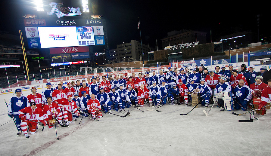 31 December 2013: Both teams pose for a group photo on the ice after the Toronto Maple Leafs v Detroit Red Wings Alumni Showdown hockey game, at Comerica Park, in Detroit, MI.