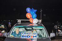 """People, including some party delegates, gather to watch the 2020 Democratic National Convention at a """"Ridin' with Biden"""" Drive-In Theater viewing event at Suffolk Downs in Boston, Massachusetts, on Wed., Aug. 19, 2020."""