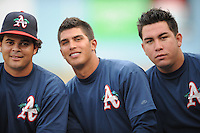 Leuris Gomez, Helder Velazquez and Juan Gonzalez during a game against the Greenville Drive at McCormick Field Asheville, NC August 12, 2010. Asheville won the game 7-2.