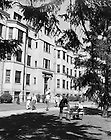 GPHR 45/0061:  Walsh Hall exterior with male students, 1948-1949.<br /> This photo was published in the 1949 Dome yearbook, page 180.  Image from the University of Notre Dame Archives.