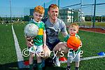 Future stars of John Mitchels with their dad, Alan O'Donoghue at their underage academy on Sunday. L to r: Feidhlim, Alan and Lochlan O'Donoghue.