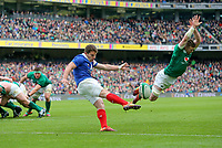 Sunday10th March 2019 | Ireland vs France<br /> <br /> Peter O'Mahony attempts to charge down Antoine Dupont's kick during the Guinness 6 Nations clash between Ireland and France at the Aviva Stadium, Lansdowne Road, Dublin, Ireland. Photo by John Dickson / DICKSONDIGITAL