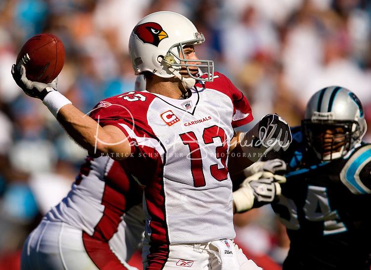 Arizona Cardinals quarterback Kurt Warner (13) works to throw a pass against the Carolina Panthers during an NFL football game at Bank of America Stadium in Charlotte, NC.