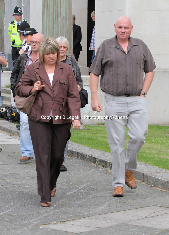 Pictured L-R: The mother of Joshua Davies, Hayley and his father Steven coming out of Swansea Crown court after their son's sentence. Friday 02 September 2011<br /> Re: A 16-year-old boy who battered his former girlfriend to death is due to be sentenced on today (Fri 02 September 2011) for her murder.<br /> Rebecca Aylward, 15, from Maesteg, was lured into a wood in Aberkenfig, near Bridgend, in October 2010. <br /> Joshua Davies denied murder, blaming his friend, but was convicted by a 10-2 majority verdict in July.