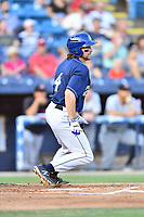 Asheville Tourists shortstop Ryan Vilade (4) swings at a pitch during a game against the Hickory Crawdads at McCormick Field on August 16, 2018 in Asheville, North Carolina. The Crawdads defeated the Tourists 3-0. (Tony Farlow/Four Seam Images)