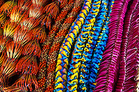 A variety of colorful,handnmade, flower leis.