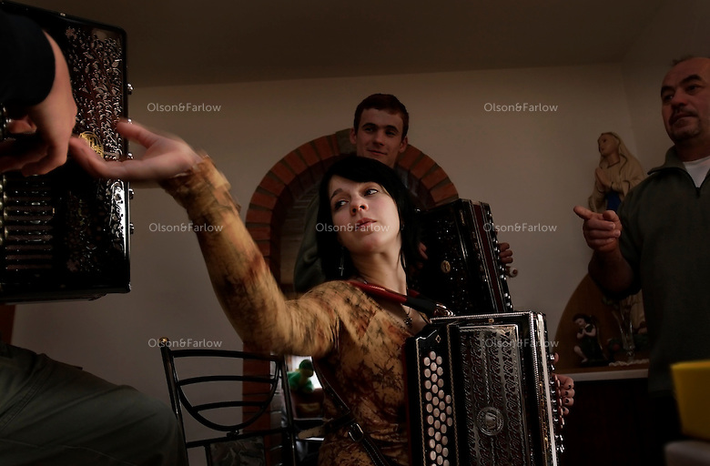 Musical Ferme family plays traditional music on accordians at parties and other celebrations.  The father played for 25 years, but the children are beginning competitions and have following in Slovenia.