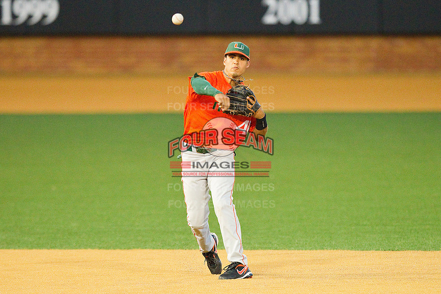 Shortstop Stephen Perez #4 of the Miami Hurricanes makes a throw to first base against the Wake Forest Demon Deacons at Gene Hooks Field on March 19, 2011 in Winston-Salem, North Carolina.  Photo by Brian Westerholt / Four Seam Images