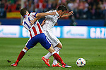 Atletico de Madrid's Gabi (L) and Real Madrid´s James Rodriguez during quarterfinal first leg Champions League soccer match at Vicente Calderon stadium in Madrid, Spain. April 14, 2015. (ALTERPHOTOS/Victor Blanco)