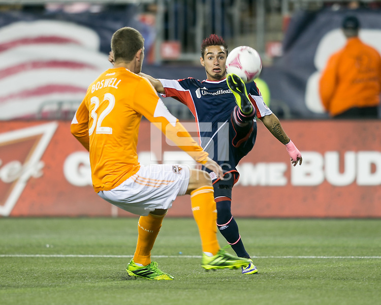 New England Revolution midfielder Diego Fagundez (14) controls a high ball as Houston Dynamo defender Bobby Boswell (32) moves in.  The New England Revolution played to a 1-1 draw against the Houston Dynamo during a Major League Soccer (MLS) match at Gillette Stadium in Foxborough, MA on September 28, 2013.
