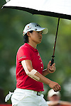CHON BURI, THAILAND - FEBRUARY 17:  Yani Tseng of Taiwan shelters from the sun under an umbrella during day two of the LPGA Thailand at Siam Country Club on February 17, 2012 in Chon Buri, Thailand.  Photo by Victor Fraile / The Power of Sport Images