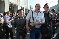 Moscow, Russia, 31/05/2010..Police arrest a demonstrator with a copy of the Russian constitution on his chest as they break up an opposition protest in central Moscow and arrest around 170 people. Opposition activists hold regular demonstrations on the 31st day of the month, protesting against restrictions on the freedom of assembly, which is protected by article number 31 of the Russian constitution.