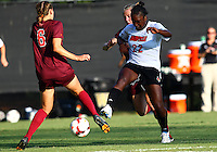 WINSTON-SALEM, NORTH CAROLINA - August 30, 2013:<br />  Christine Exeter (22) of Louisville University blasts the ball towards Jodie Zelenky (6) of Virginia Tech during a match at the Wake Forest Invitational tournament at Wake Forest University on August 30. The game ended in a 1-1 tie.