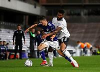 21st September 2021; Craven Cottage, Fulham, London, England; EFL Cup Football Fulham versus Leeds; Cyrus Christie of Fulham challenges Daniel James of Leeds United