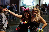Pictured: Two young women wave to the camera. Sunday 31 December 2017 and 01 January 2018<br /> Re: New Year revellers in Wind Street, Swansea, Wales, UK