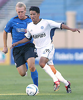 Rapids Defender Mark Chung dribbles the ball away from Earthquakes Midfielder Chris Roner during the first half of the game at San Jose Spartan Stadium in San Jose, California on July 12th, 2003.  Rapids defeats Earthquakes, final score is 2-0.