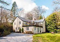 BNPS.co.uk (01202) 558833<br /> Pic: KnightFrank/BNPS<br /> <br /> The sale also includes a three-bedroom lodge house, four-bedroom farmhouse with 70.85 acres of farmland, just under 30 acres of woodland and almost 140 acres of moorland in the national park.<br /> <br /> A historic English country estate with a French chateau feel and royal connections is on the market for £5.5m.<br /> <br /> The site of Grade II listed Yarner House was once governed by William the Conqueror, mentioned in the Domesday Book and a popular hunting site in Tudor times.<br /> <br /> The seven-bedroom house sits in a 247-acre estate on the edge of Dartmoor National Park and has stunning views over the surrounding landscape, including Yarner Wood.<br /> <br /> The ancient woodland was once part of the property until 1952 when it was sold to the Nature Conservancy to become one of the first national nature reserves.<br /> <br /> Where the current Yarner House is built, it is thought to have had a hunting lodge in Tudor times, with connections to Henry VII, Henry VIII, Edward VI and Queen Mary.