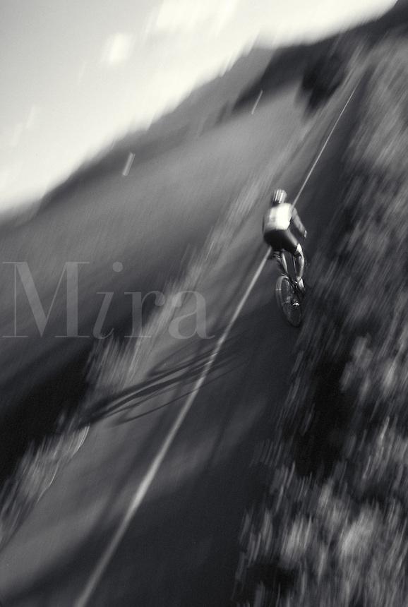 Man road biking on bike path in Rocky Mountains, CO. Bruce Ruff (MR 613). Colorado.