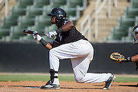 Micker Adolfo (37) of the Kannapolis Intimidators squares to bunt against the Greensboro Grasshoppers at Intimidators Stadium on July 17, 2016 in Greensboro, North Carolina.  The Intimidators defeated the Grasshoppers 3-2 in game one of a double-header.  (Brian Westerholt/Four Seam Images)