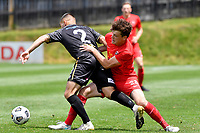 Edward Wilkinson of Canterbury United competes for the ball with Justin Gulley of Team Wellington during the ISPS Handa Men's Premiership - Team Wellington v Canterbury Utd at David Farrington Park, Wellington on Saturday 19 December 2020.<br /> Copyright photo: Masanori Udagawa /  www.photosport.nz