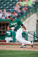 Fort Wayne TinCaps first baseman Carlos Belen (27) follows through on a swing during a game against the West Michigan Whitecaps on May 17, 2018 at Parkview Field in Fort Wayne, Indiana.  Fort Wayne defeated West Michigan 7-3.  (Mike Janes/Four Seam Images)