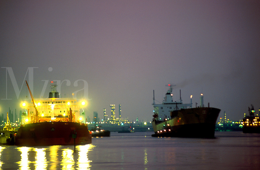 Cargo ships in the Houston ship channel lit up at night. Houston, Texas.