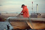 Native American salmon fisherman, gill netting, Duwamish river, Seattle, Puget Sound, Washington State, Suquamish Tribe,