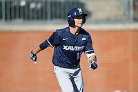 Mitch Gallagher (12) of the Xavier Musketeers hustles down the first base line against the Charlotte 49ers at Hayes Stadium on March 3, 2017 in Charlotte, North Carolina.  The 49ers defeated the Musketeers 2-1.  (Brian Westerholt/Four Seam Images)
