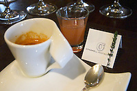 Coffee and digestive in a designer cup to end an opulent lunch, a branch of thyme and the card of the restaurant. The O'Farrell Restaurant, Acassuso, Buenos Aires Argentina, South America