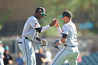 Salt River Rafters infielders Geraldo Perdomo (7) and Royce Lewis (9) celebrate after winning the Arizona Fall League Championship Game against the Surprise Saguaros on October 26, 2019 at Salt River Fields at Talking Stick in Scottsdale, Arizona. The Rafters defeated the Saguaros 5-1. (Zachary Lucy/Four Seam Images)