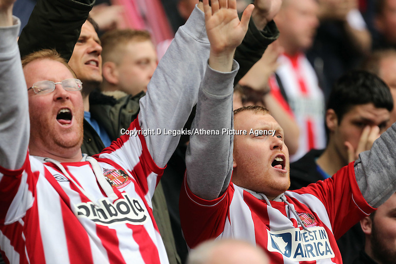 Pictured: Sunderland supporters cheering. Sunday 11 May 2014<br /> Re: Barclay's Premier League, Sunderland v Swansea City FC at the Stadium of Light, Sunderland, UK.