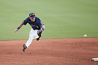 Wingate Bulldogs second baseman McCann Mellett (9) fields a ground ball during the game against the Central Missouri Mules during the 2021 DII Baseball National Championship at Coleman Field at the USA Baseball National Training Complex on June 12, 2021 in Cary, North Carolina. The Bulldogs defeated the Mules 5-3. (Brian Westerholt/Four Seam Images)