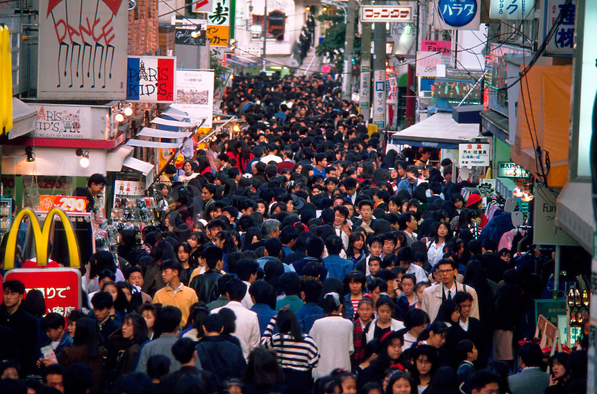 Overview of crowds along Takeshita-dori; a popular Japanese street for shopping. Tokyo, Harajuku district, Japan.