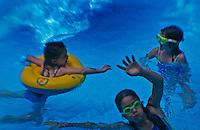 Kids play in pool