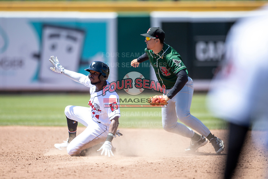Lansing Lugnuts outfielder Lester Madden (14) slides safely into second base on May 30, 2021 against the Great Lakes Loons at Jackson Field in Lansing, Michigan. (Andrew Woolley/Four Seam Images)