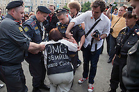 "Moscow, Russia, 31/05/2010..A demonstrator wearing a banner saying ""The OMON murdered my son"" collapses after being arrested by OMON riot police as they break up an opposition protest in central Moscow and arrest around 170 people. Opposition activists hold regular demonstrations on the 31st day of the month, protesting against restrictions on the freedom of assembly, which is protected by article number 31 of the Russian constitution."