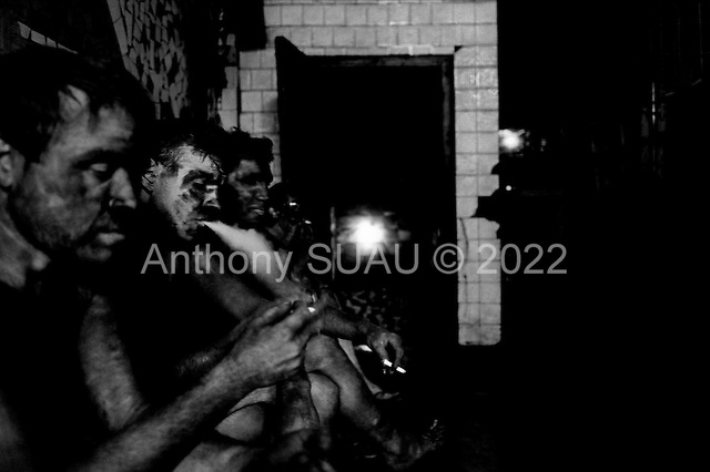 Donets'k, Ukraine.August 1998.Miners sit for a cigarette after their shift and before heading in to the showers. The Ukrainian miners have suffered recently from strikes, the lack of pay and a series of accidents in which many miners have been killed in the past year..